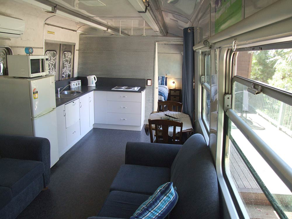Pelican Waters train carriage open plan kitchen and living areas